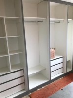 Large fitted open front wardrobe with cube shelves
