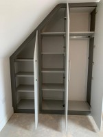 Large sloping fitted wardrobe with shelves