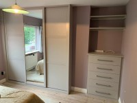 Fitted bedroom unit with 4 door 1 mirrored wardrobe and 5 draw chest of drawers with over head shelves