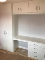 Extra large fitted 2 door wardrobe and  4 drawer desk with 4 over head cupboards