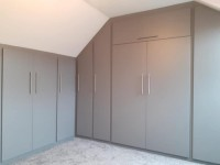extra large fitted unit 9 doors with over head storage