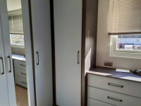 Large fitted bedroom 4 door 1 mirrored wardrobe and match 3 draw chest of drawers