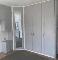 Large fitted corner bedroom unit 4 door with matching drawers and over head cupboards